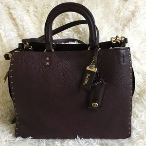 Coach Rogue in Oxblood with Rivets